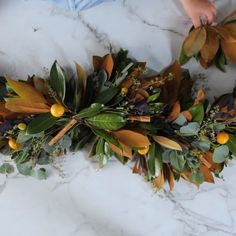 Skip the traditional table runner for this year's holiday meal and create a luscious garland of magnolia leaves and festive embellishments. We'll show you how to make the garland and give you our best styling inspiration. Natural Christmas, Simple Christmas, Christmas Time, Christmas Leaves, Christmas Flowers, Xmas, Magnolia Garland, Magnolia Leaves, Thanksgiving Wreaths