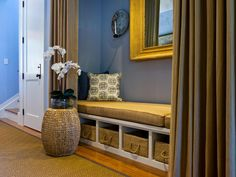 A niche in the entry hallway is the perfect spot to relax, with a small daybed and heavy duty curtains that block out all light. Storage bins underneath the bed hold everyday items while keeping them neatly tucked away. Take the Dream Home 2013 Tour>>