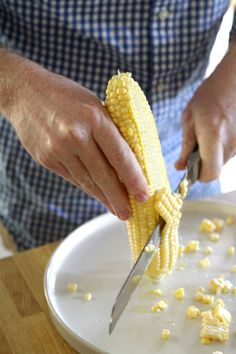 Cutting fresh corn from the cob.