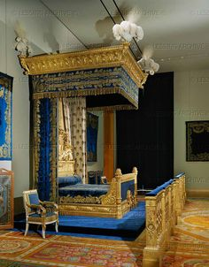 Brion,Pierre-Gaston.Lit de Charles X - Bed of Charles X,in the Chateau des Tuileries,1824.   Sculpted in gilt walnut; blue silk velvet   220 x 240 x 210 cm