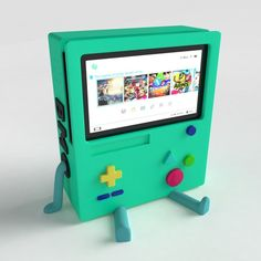 printable model BMO Stand for Nintendo Switch bmo adventuretime, available in STL, ready for animation and other projects Nintendo Switch Accessories, Gaming Accessories, Kid Paddle, Machine 3d, Vintage Disney Posters, Nintendo Switch Animal Crossing, 3d Printing Business, Mundo Dos Games, Video Game Rooms