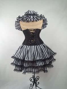 Circus Black and White Striped Bustle ONLY by DelightfullyDeviant, $50.00  It looks like something from The Night Circus