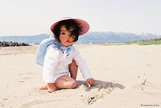 Asian baby on the beach