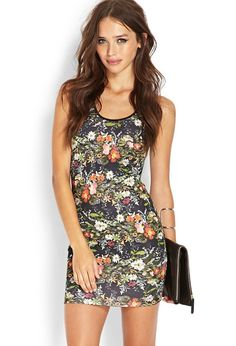 This scuba knit dress features a floral print and cutout mesh back. This sleeveless number is com...