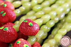 "Very Hungry Caterpillar party: grape skewers with strawberry ""head"""