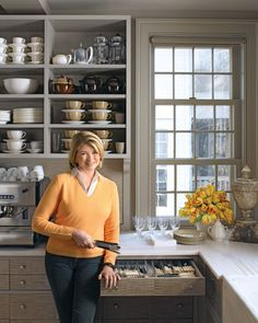 """Clever ideas, practical storage, unusual solutions -- Martha shares her secrets for creating a kitchen that works.  Open up and use every inch. Shelving in place of upper cabinets makes the room look lighter and airier. """"I use everything in my kitchen regularly, and shelves make it all accessible,"""" Martha says. """"These nearly reach the ceiling, putting underused space to work."""" A combination of shelving and cabinets makes sense if you don't want everything on display.  See Martha's answers…"""