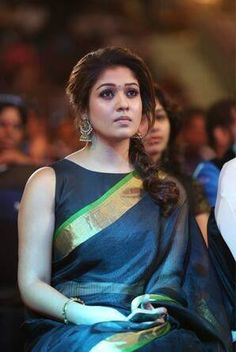Nayanthara in a plain silk saree with a simple border, paired with a boat neck blouse and antique earrings #weddings #formal