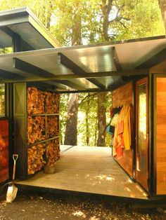 Firewood storage/coats in breezeway, I really like this idea