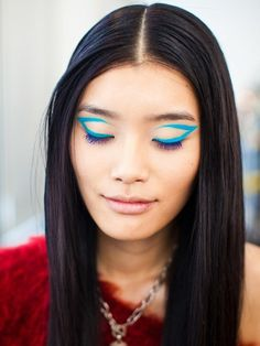 Look who's going bold with bright blue graphic eyeliner. Go ahead, let your blue wings fly this spring.