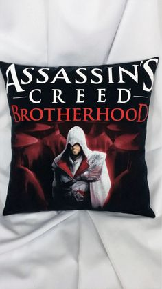 Bring the ancestor of Desmond Miles to your home for protection from the Templar! This gamer pillow cover is made from an Assassin's Creed Brotherhood shirt. It features Ezio Auditore da Firenze in a