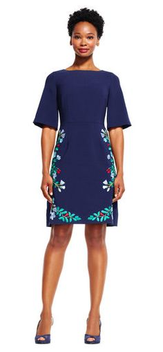 Adrianna Papell | Short Sleeve A-Line Dress with Floral Embroidered Skirt | A little floral goes a long way in this office-ready dress. This short sleeve dress features a fitted a-line silhouette and an embroidered floral motif at the skirt. A boat neckline and flared sleeves complete the design. For day, pair this dress with a matching heel and then elevate the look for cocktail hour with a simple clutch.
