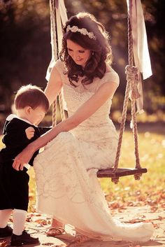 Beautiful bride on a simple swing. www.cedarwoodweddings.com