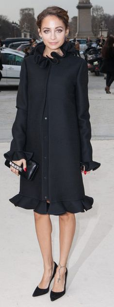 Who made  Nicole Richie's red dress, black ruffle coat, and studded clutch handbag that she wore in Paris on March 5, 2013?