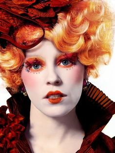 EFFIE IN CATCHING FIRE!!! She's orange and beautiful!!!!!! I LOVE how much detail goes into the makeup in THG movies!!!