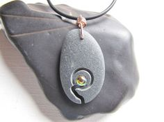 There is a crack in everything, that's how the light gets in-Black Beach Stone Pendant-Gold Shimmery Fused Glass Jewel-Hope-Wellness-Truth