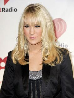 An oval face shape makes it possible to pull off many different styles, including bangs. #CarrieUnderwood #Hairstyles