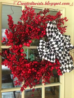 Red Berry Christmas Wreath with Black and White Harlequin Ribbon