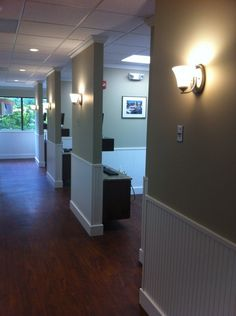 hallway design, could remove all the doors an have one recessed sliding door for the exam room for privacy