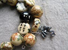 B23 Memorywire Bracelet w/Dragon Charm Black Ceramic Beads