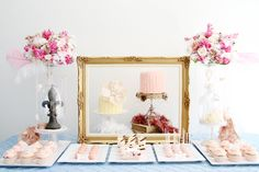 dessert table with pink and gold ruffle cakes in gold frame