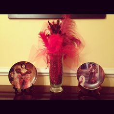 Gone With the Wind decor I have in my dining room.    All materials were bought at Michaels...red beads, vase, various shades of red feathers, red tull, (plates bought seperately)!  Inspiration was Scarlett's famous red dress she wore to Ashley's birthday party.