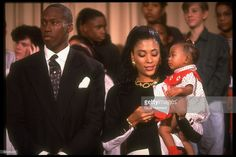 Track star couple Al Joyner & Flo Jo Griffith Joyner, w. baby Mary in her arms, paying call at Alice Deal Jr. HS.