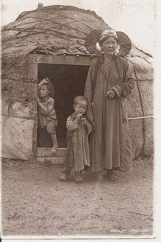 mongolian yurt (yurta). Mongolian woman with children. Old photo