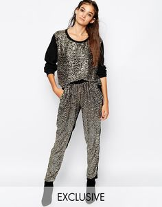 "Trousers by Religion Woven fabric Sequin embellishment Stretch waist Side pockets Regular fit - true to size Hand wash 100% Viscose Our model wears a UK S/EU S/US XS and is 175cm/5'9"" tall"