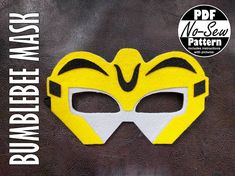 """Make your own """"Bumblebee No-Sew Felt Rescue Bot Mask"""" with this PDF PATTERN; perfect for parties, Halloween, gifts and playing dress up. Please note this listing is for the PDF PATTERN only. Pattern Includes: • A materials and supply list • Instructions with tips, pictures, and"""