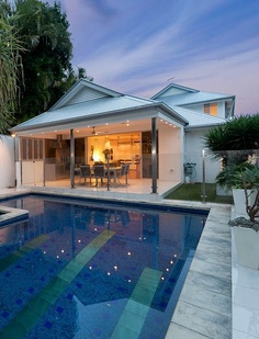 Perfect Brisbane backyard - level grass play area, amazing swimming pool and open plan kitchen, lounge, dining opening out to outside entertaining patio area.