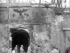 Churchill Visiting the Siegfried Line. Frame capture from British Pathé FILM ID:2117.09. Exact location of this structure is unknown, but there are numerous shots of the Canadian first Army. Sign with flash for Canadian II Corps occurs just before this scene. People in the film include Harry Crerar, Sir Alan Brooke, Guy Simonds, Bernard Montgomery, Gen Simpson (US 9th Army).