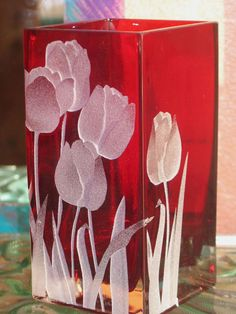 Carved / Sandblasted design of Tulips on red vase.