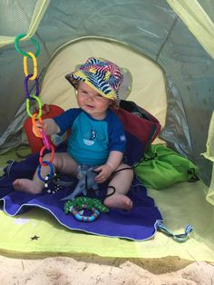 Everything youll need for baby's first summer holiday in the sun - anti-UV baby tent for the beach
