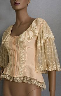 """Edwardian style vintage blouse, 1970s. Finely fashioned from peach colored silk crepe de chine with French seams and rows of pin tucks, the princess line seams give the blouse a figure flattering shape (4"""" longer in back). The hem border is of expensive handmade Cluny lace, a Victorian handmade bobbin lace, which is worked in linen thread and has braided bars and small petal-shaped wheat ears. This beauty gives you the romantic allure of an antique in a garment sturdy enough to wear"""