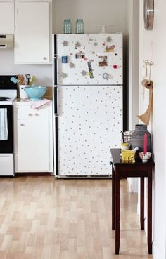 Rent and hate your fridge or own and can't afford to replace it right now? Do what the creative minds behind At Home In Love did and add some polka dots to your fridge to add some fun.