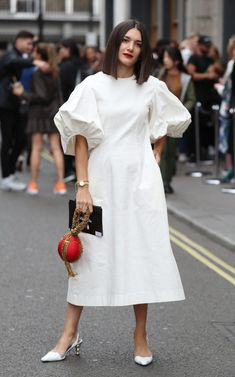 From checked jumpsuits to printed shirt dresses, the chicest street style looks from London Fashion Week