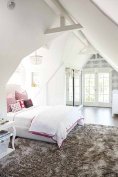 A little girl's dream: Daughter Harper's bedroom is a vast white space with accents of pin...