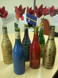 Another picture of the upcycled bottles for table decorations with their egg box red roses! #NCCUpcycling