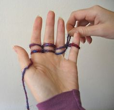 finger knitting tutorial. must continue to do this with Cash. I think it will help his coordination.