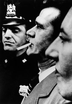 William Klein. Two heads and Cop 1955 NY http://lens.blogs.nytimes.com/2013/03/15/william-kleins-paint-and-light-show/?_r=0