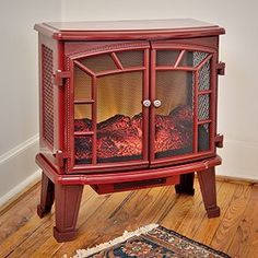 The Duraflame 950 Cranberry Electric Fireplace Stove with Remote Control - adds a punch of color and classic, charm with its antique wood stove design. Electric Wood Stove, Electric Stove Fireplace, Electric Fireplaces Direct, Duraflame Electric Fireplace, Portable Fireplace, Fireplace Heater, Fireplace Inserts, Antique Wood Stove, How To Antique Wood