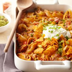 Chicken Enchilada Pasta~For a Tex-Mex twist on pasta, fill shells with chicken, refried beans, and enchilada sauce. After baking, top the casserole with tortilla chips and a dollop of sour cream.