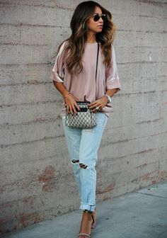 Chic Combo: Sincerely Jules styles our Ready-To-Wear Daisy Blouse to perfection with a pair of boy-fit denim.