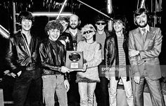L-R Jimmy Destri, Nigel Harrison, Chris Stein, Chris Wright of Chrisalys Records, Debbie Harry, Clem Burke, Frank Infante and Doug D'Arcy also of Chrysalis Records photographed at Blanford Studios in Marylebone, London on 8th March 1978 during the presentation of a silver disc to Blondie cellebrating their single Denis reaching sales of 250,000 .