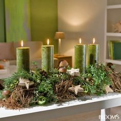 Yule style!! Perfect Christmas centerpiece or mantel decoration with green candles and gray moss!
