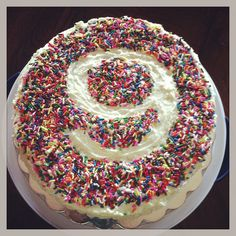 sprinkle cake! Make a cake, ice it, lay down a number cutout and have sprinkle fun. Afterwards, slowly pick up the number cut out and Voila! You have your cake! Super easy!!!!