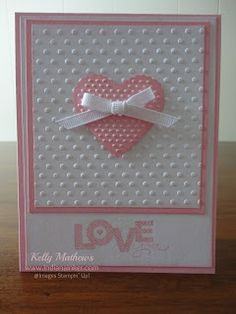 Indiana Inker: Love You Card, Cardstock - Pretty in Pink, Whisper White Ink - Pretty in Pink Stamp Set - Seasonal Sayings 128006 (w); 128009 (c) Embosslit - Scalloped Heart #117332 Folder - Perfect Polka Dots #117335