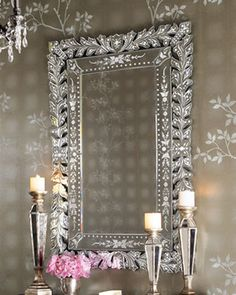 """""""Venetian"""" Mirrorin combination with this wallpaper produces a jewel box look.  Think stunning powder room along with a great chandelier -  Horchow mirror"""