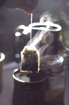 saw this Pin,   A hot cup of tea in the morning...love the steam captured, the teabag ready to steep, to brew, to exude flavours..