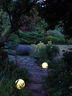 Designs of driveway pillars and globe lights at night